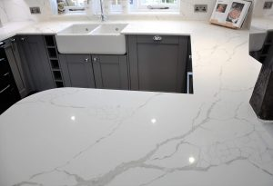Calacatta Quartz Worktops with matching Breakfast bar and window Cill.